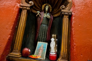 MEXICO CITY, MEXICO - MAY 27: A figurine of Santa Muerte (Saint Death) seen in a temple in the historical center of Mexico City, Mexico, on May 27, 2011. The religious cult of Santa Muerte, a syncretic fusion of Aztec death worship rituals and Catholic beliefs, has rapidly expanded. In the past decades, original Santa Muerte's followers (such as prostitutes, pickpockets and drug traffickers) have merged with thousands of ordinary Mexican Catholics. Although the Catholic Church considers the cult as devil worshipping, on the first day of every month, crowds of Santa Muerte's devotees fill the streets of Tepito. Holding skeletal figurines, they pray for power healing, protection and make petitions to ?La Santísima Muerte?. (Photo by Jan Sochor/Latincontent/Getty Images)